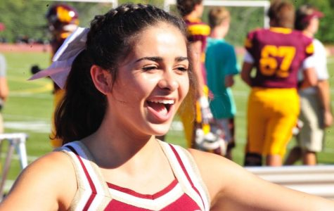 Arianna works to pump up the crowd at a recent football game.