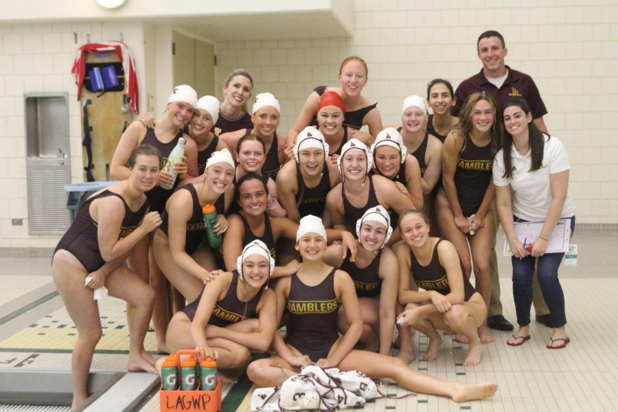 Emily+celebrates+the+end+of+a+great+season+with+her+water+polo+teammates.+