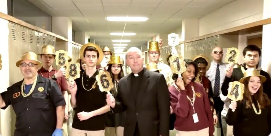Fr.+McGrath+and+students+dance+down+the+halls+in+support+of+this+year%27s+Ramble.+