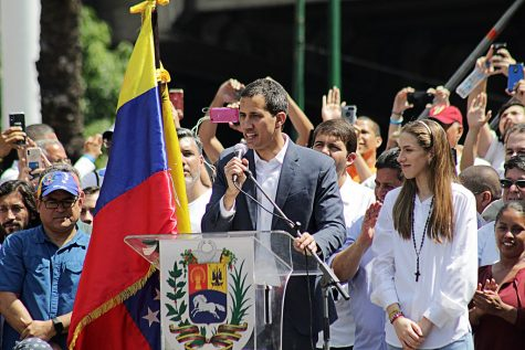 Juan Guaido speaks to protestors in Caracas. The country has been thrown into turmoil over recent elections.