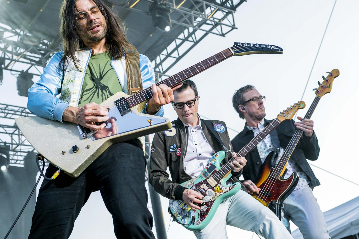 From left to right: Brian Bell, Rivers Cuomo and Scott Shriner Rock out at a show. Drummer Pat Wilson is not featured.
