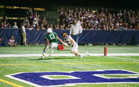 Rory Boos comes down with a touchdown catch in last year's victory over New Trier.