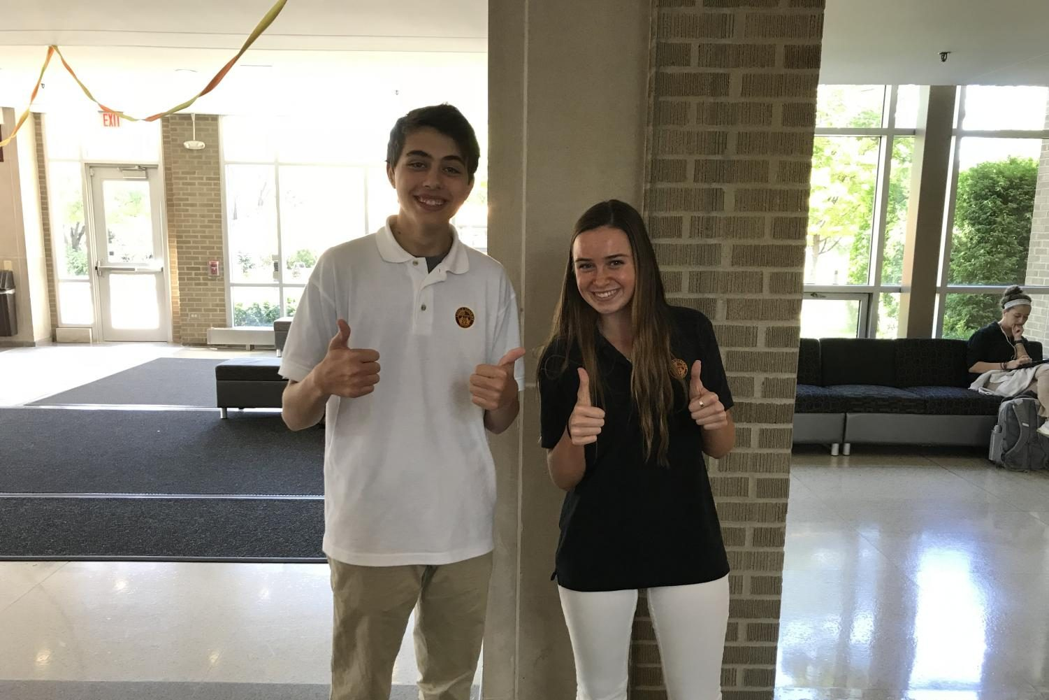Matthew Kelsh and Frannie Whelan give a thumbs up to the environment.