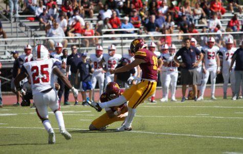 Junior Nate Van Zelst kicks a field goal. The field goal was the longest of his High School career.