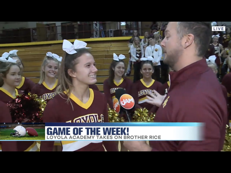 JamTV anchor Jon Hansen interviews Senior cheer captain Olivia Norton.