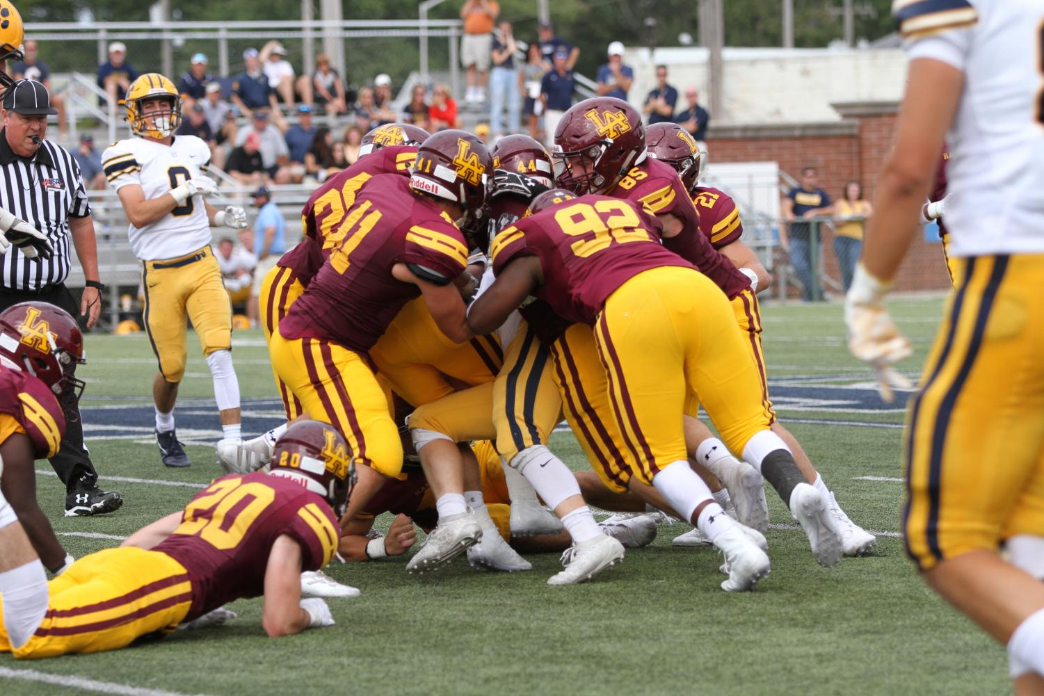 Rambler defense makes tackle against St Ignatius Cleveland. Ramblers suffered a defeat 27-10