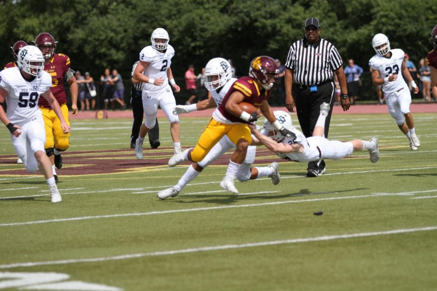 Junior Aidan Brownlee runs with the football in win over New Trier.
