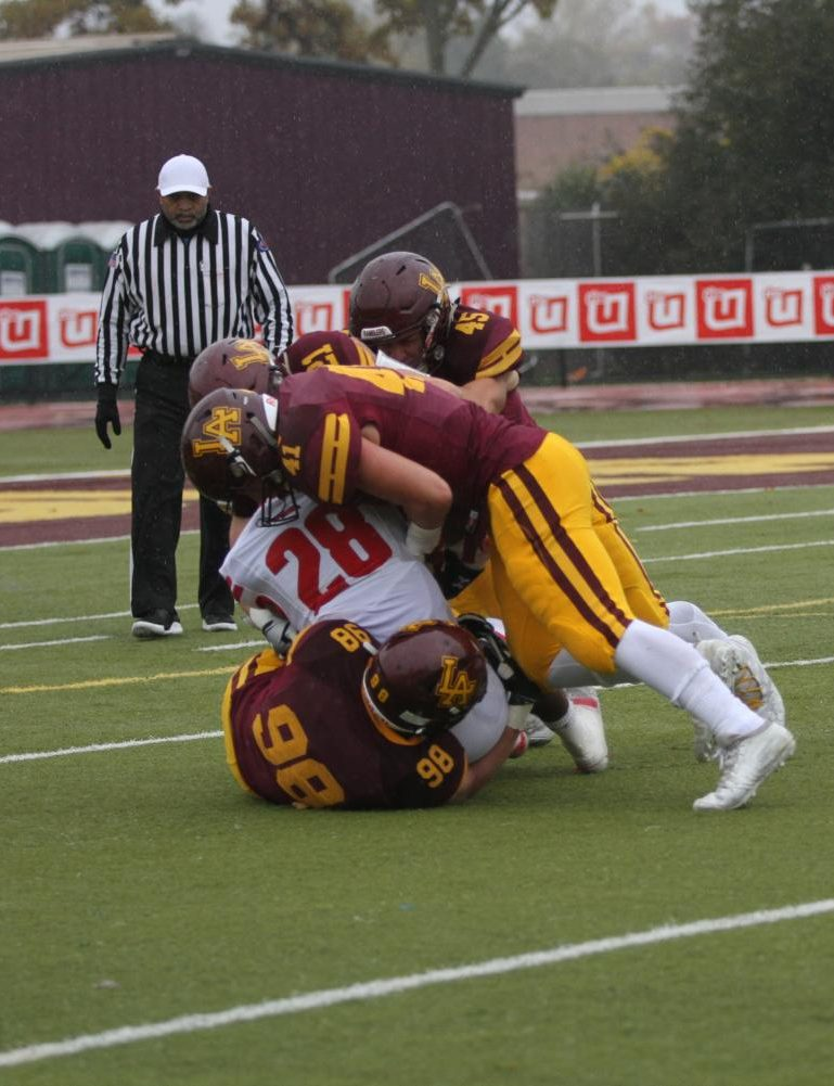 The Loyola defense swarms the Marist offense in the 6-14 loss. They look to bounce back in the first round of the playoffs against Maine South.