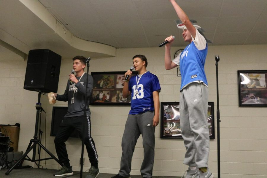 Juniors Roman Sudimac, Joe Kohl and Liam Brandstrader use the  karaoke machine during their lunch periods.