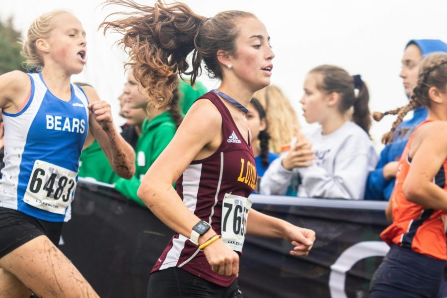 Junior Sarah Jay pushes ahead during the Palantine meet. Jay would go on to race at the State finals after a IHSA ruling.