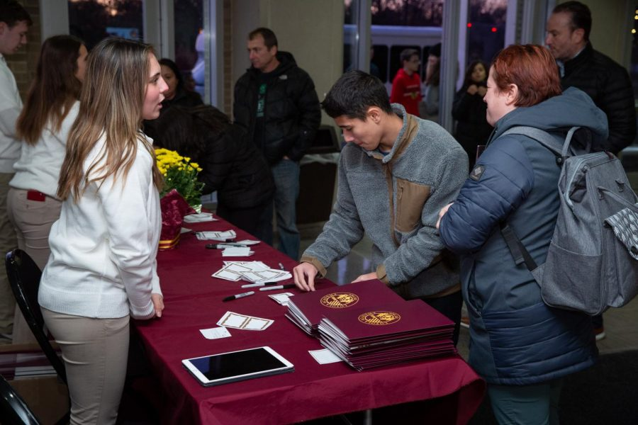Eager+future+students+sign+in+to+the+Loyola+Academy+Open+House.++These+students+were+matched+with+tour+guides+who+showed+them+around+the+campus.