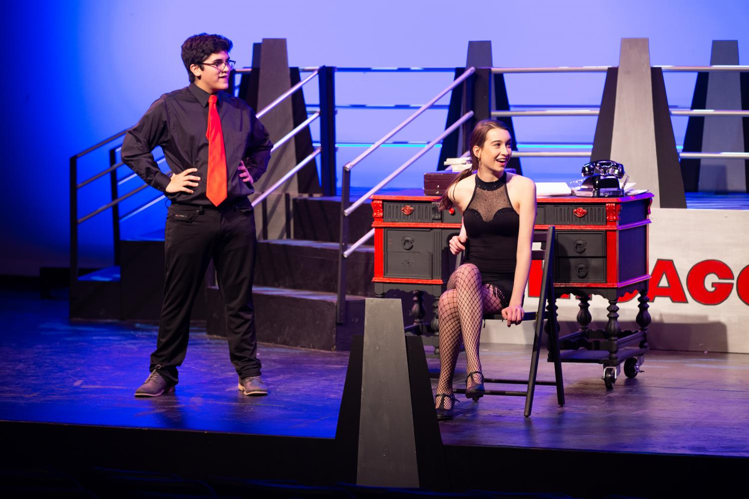 Lawyer Billy Flynn (Kameron Rojas-Schueneman) meets with client Roxie Hart (Nonie Sharp) to plot ways to not only get her off the hook, but also rise to fame. Check out the muscial the weekend of Nov 14-17.