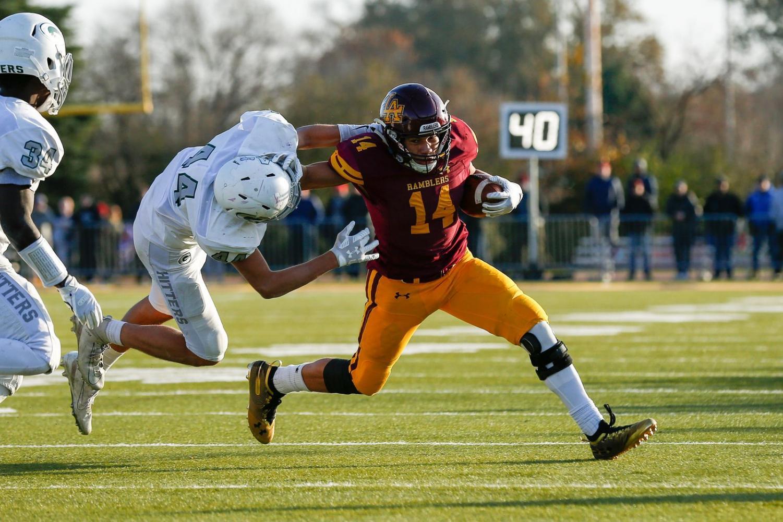 Loyola's Vaughn Pemberton (14) holds off Glenbard West's defense