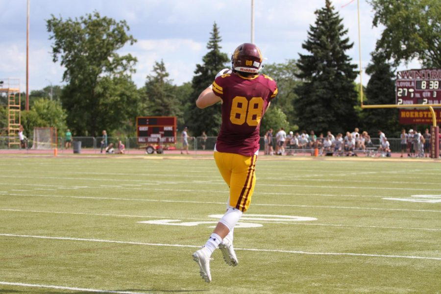 Senior wide receiver Matty Mangan makes a catch in an early game against New Trier. The Ramblers will need all their weapons to defeat Glenbard West in round two of the playoffs.