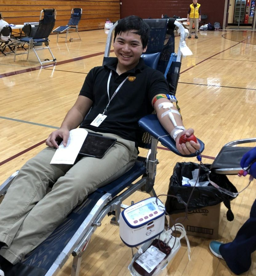 Loyola+student+gets+his+blood+drawn.+He+was+one+of+the+many+donors+at+Loyola%27s+drive+last+winter.