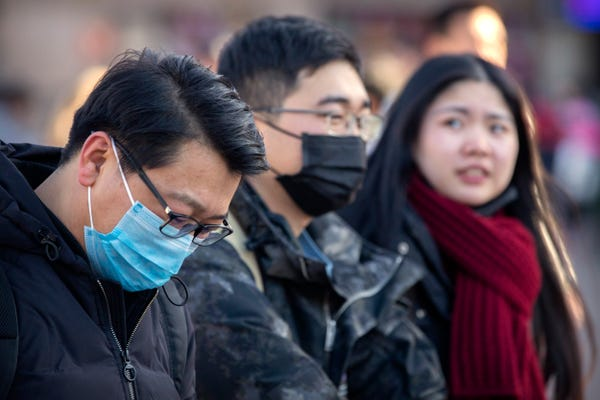 Many Chinese citizens wear surgical masks to prevent the virus from spreading too easily.