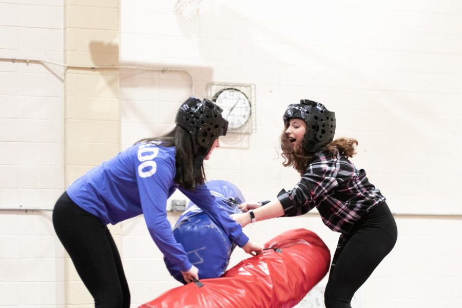 Students+battle+it+out+at+the+inflatable+jousting+activity.+Late+Night+at+Loyola+had+a+plethora+of+activities+to+enjoy+on+their+Saturday+night.+