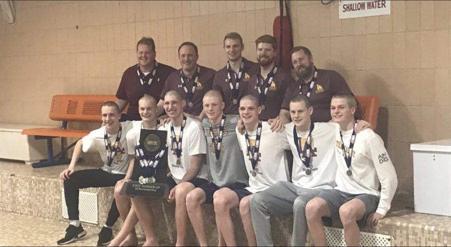 The boys swim team celebrates their big victory.