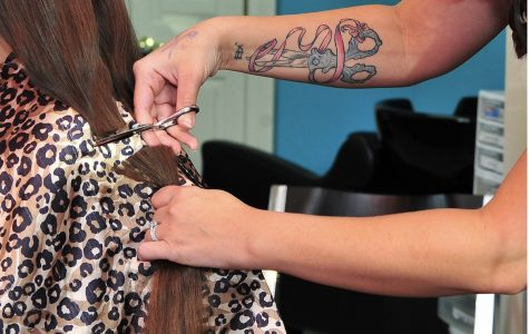 Donor gets hair cut for Wigs For Kids. All donations have helped children for thirty years.