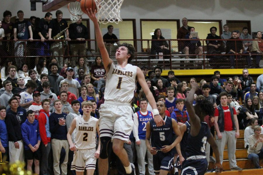 Senior Matty Enghauser shoots an easy lay-up against DePaul. Matty and his teammates rolled into the playoffs as the number one seed.
