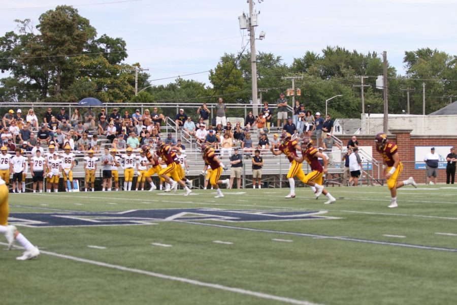 Kicker Nate Van Zelst kicks off Loyola's 2019 fall football season, something that will not happen this year due to the postponement of fall sports.