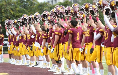 The 2019 Loyola football team acknowledges the crowd before a game. Scenes like these won't be happening in the fall of 2020.