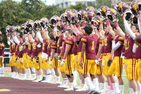 The 2019 Loyola football team acknowledges the crowd before a game. Scenes like these won