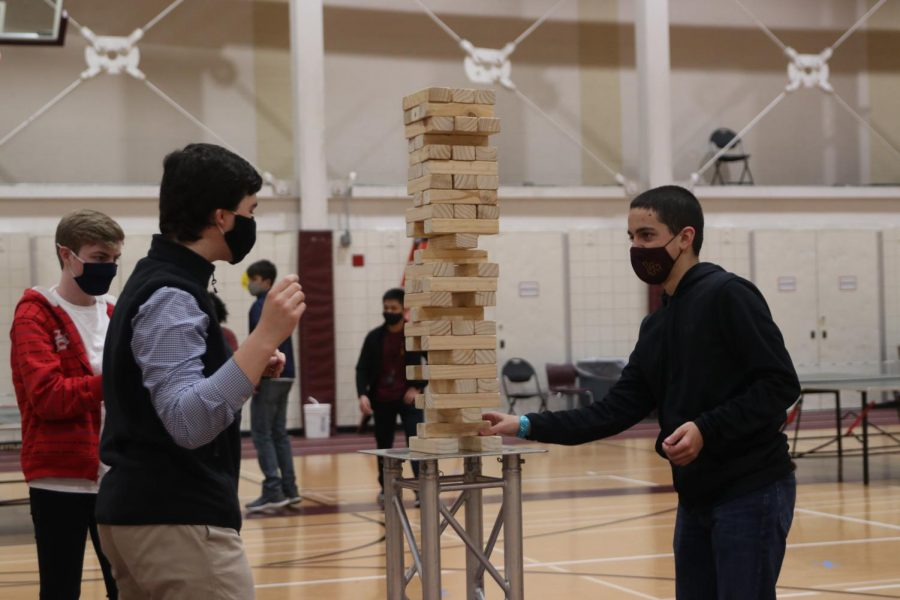 Freshmen stand back as they play giant jenga at the Not a Dance Dance. The event was a way to bring together the entire freshman class.