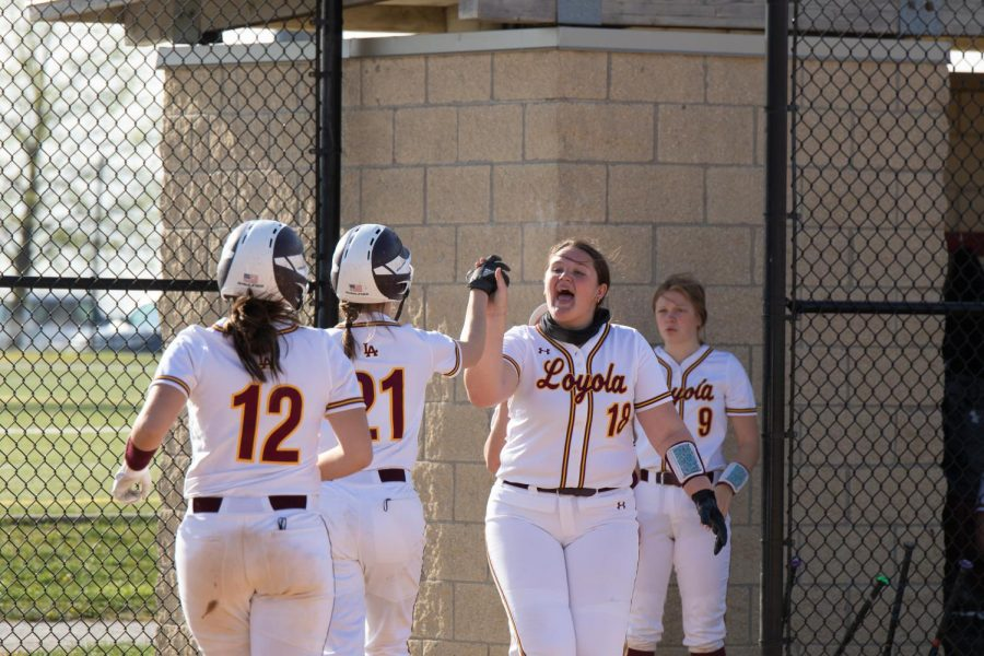 The softball team celebrate some runs at their game on the hill. The team is just one of seven at the hill who compete with the benefit of a locker room.