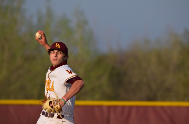 Senior Daniel Reischl reaches back for a pitch in the first inning. He would go on to pitch six solid innings, leading to his first win of the year.