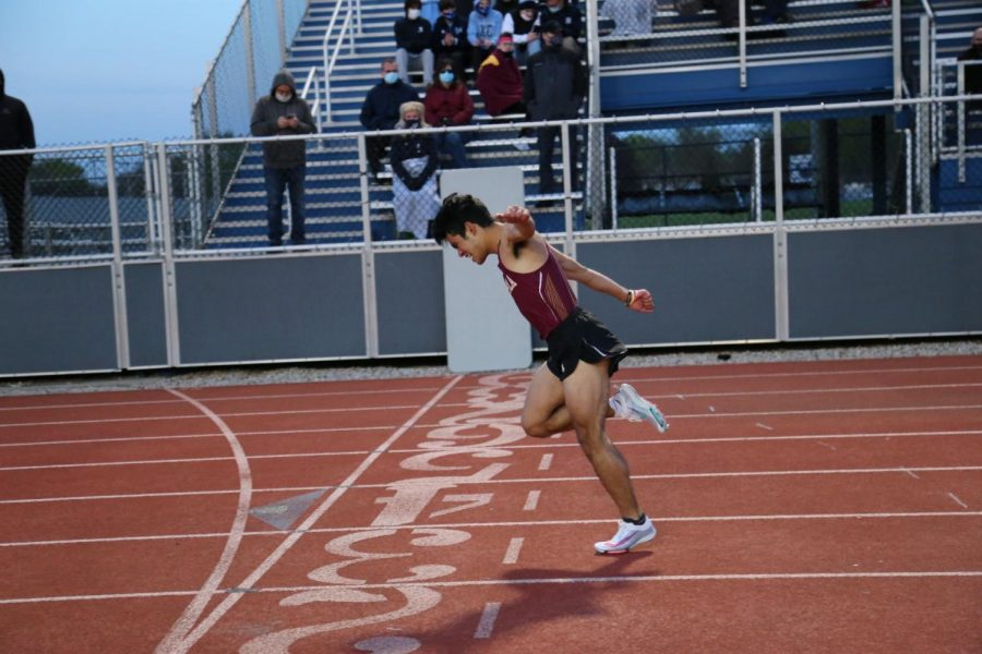Junior Seichi Shinozaki leans at the line to ensure his win in the 400m. The team came out strong in their first meet of the season.