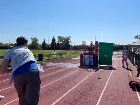 Liam Zidar takes aim at Mr. Karch during Mondays dunk tank.