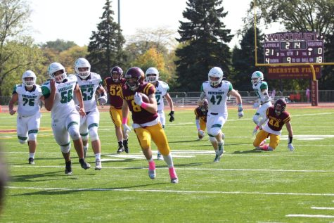 Corey Larson rushes past the Providence defense. The Ramblers would go on to shut out the Celtics 40-0.