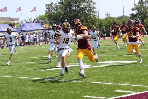 Danny Collins races down field against the RedHawks. The Ramblers would go on to win their homecoming game.