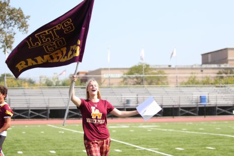 Ashley Voss waves the Rambler flag with pride during the Pep Rally.